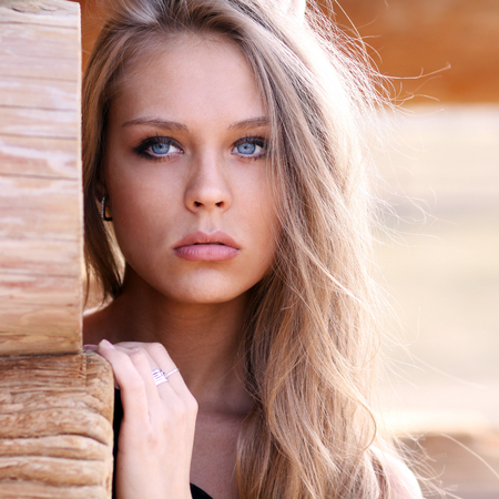 Portrait close up of young beautiful blonde woman photo