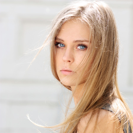 one eyed: Portrait close up of young beautiful blonde woman
