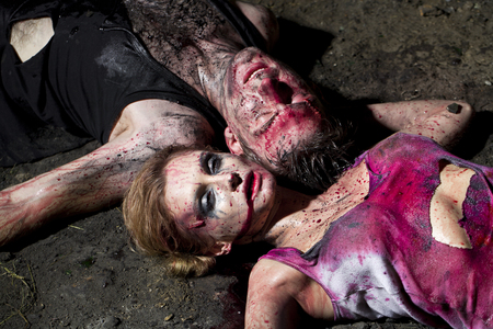 putrefy: Couple of bloody man and woman lying on the ground