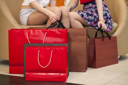 pairs: Two pairs of female legs with shopping bags