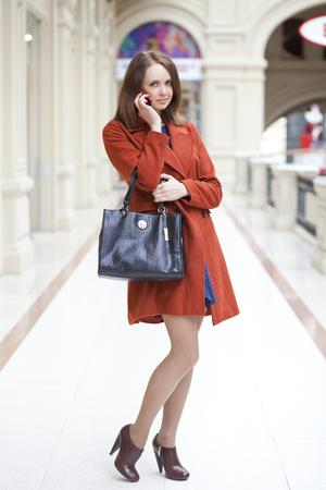 go inside: Beautiful young woman walking in the shop