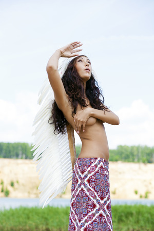 sexy topless women: Young woman in costume of American Indian Stock Photo