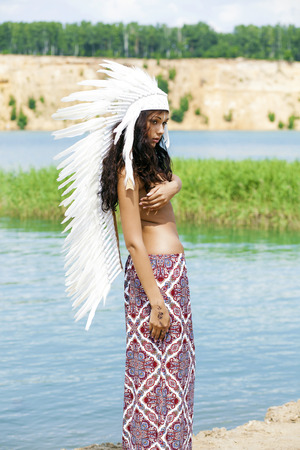 nude brunette: Young woman in costume of American Indian Stock Photo