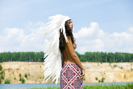 topless women: Young woman in costume of American Indian Stock Photo