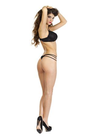 femmes nues sexy: Fashion portrait d'un modèle professionnel en sous-vêtements sexy noir, vue de dos, isolé sur fond blanc Banque d'images