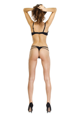 naked sexy woman: Fashion portrait of a professional model in black sexy underwear, back view, isolated on white background