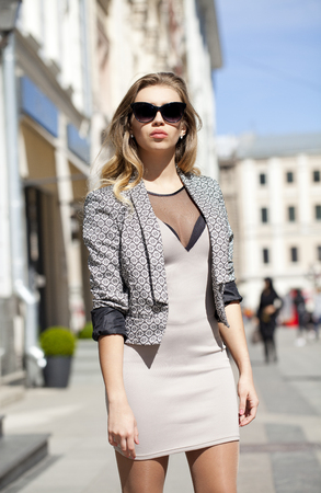 decollete: Portrait close up of young beautiful blonde woman, on spring street background