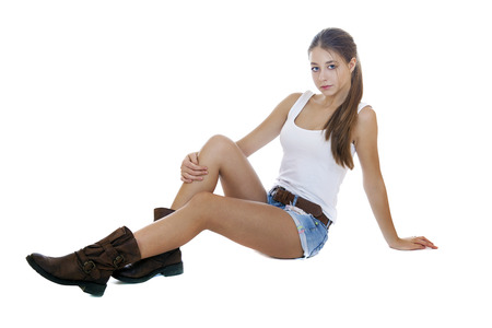 teen legs: Portrait in full growth the young girl in blue jeans short, isolated on white background Stock Photo
