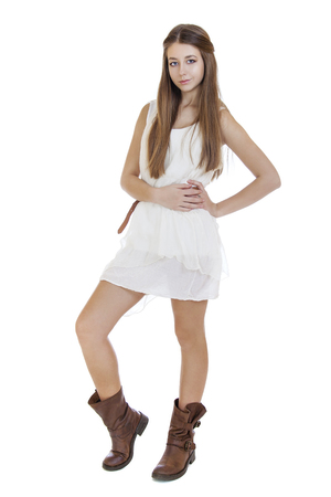 Fashion  beautiful girl with modern white dress posing in studio, isolated on white photo