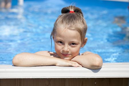 bikini wear: Happy little Girl in blue bikini swimming pool Stock Photo