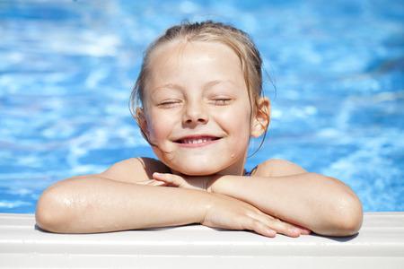 little girl child: Happy little Girl in blue bikini swimming pool Stock Photo