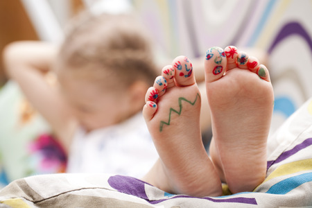 laying: Body part, Painted childrens fingers feet