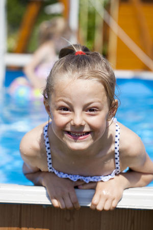 summer holiday bikini: Happy little Girl in blue bikini swimming pool Stock Photo