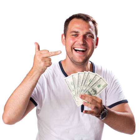 35 years old man: Happy young man holding a pile of cash isolated on white background Stock Photo