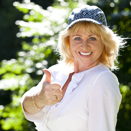 people smile: Close up portrait of lovely middle aged woman in the summer park