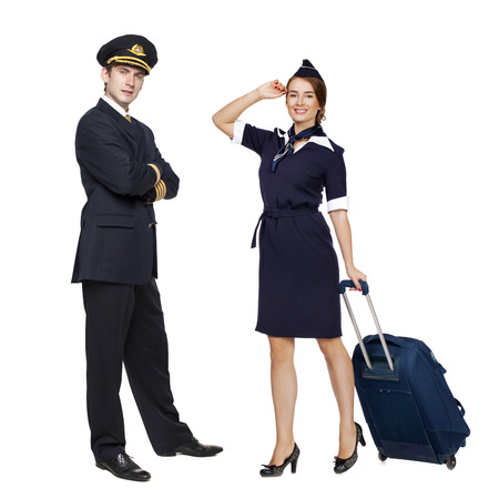 Captain of the aircraft and a beautiful flight attendant in a dark blue uniform, isolated on white background Archivio Fotografico