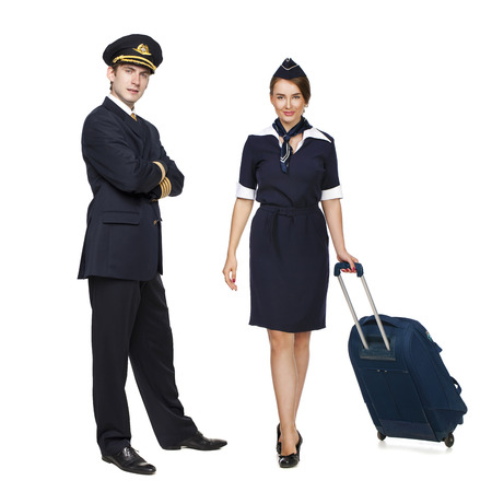 aircrew: Captain of the aircraft and a beautiful flight attendant in a dark blue uniform, isolated on white background Stock Photo