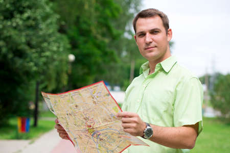 good looking: Young male tourist with map in hand good looking. Tourist map of the city of Moscow, Russia (no trademark)
