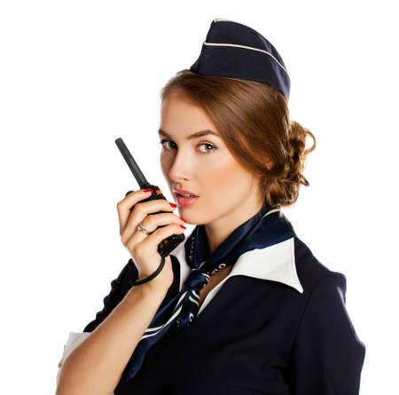 cb: Beautiful smiling stewardess with cb radio, isolated on a white background