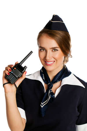 cb: Beautiful smiling stewardess with cb radio, isolated on a white background