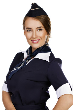 dark haired: Close up, beautiful dark haired young business woman dressed in a dark blue suit with a blue scarf smiling, isolated on white background