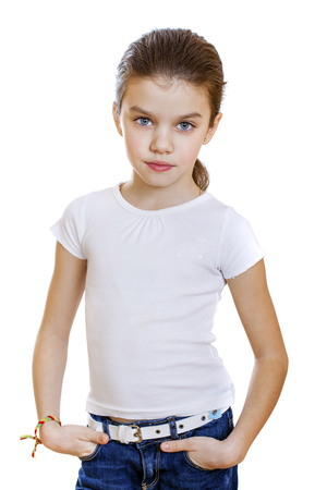eyes downcast: Sad little girl, isolated on white background