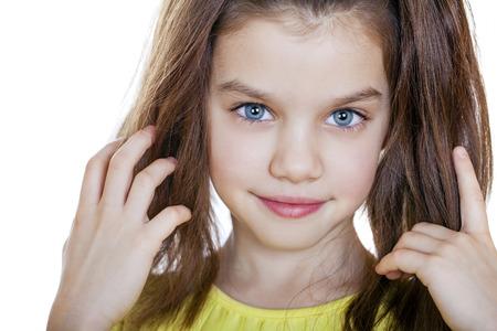 美しい少女、白い背景の上のスタジオの肖像画 写真素材