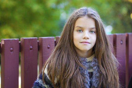 nine year old: Close up portrait of a beautiful nine year old little girl in autumn park