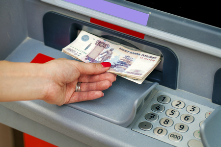 withdraw: Female hands closeup with Russian rubles - woman withdraw money at cashpoints