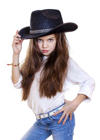 black cowgirl: Portrait of a beautiful little girl in a black cowboy hat, studio on white isolated background