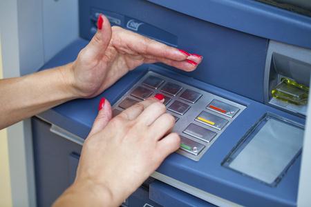Female arms, ATM - entering pin Stok Fotoğraf