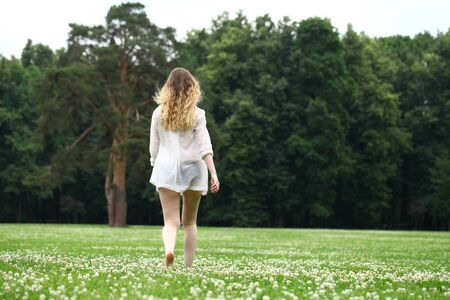 walk away: Portrait in full growth, Young beautiful blonde woman walking away