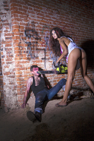 vendetta: Psychotic woman with a chainsaw covered in blood