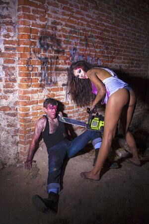 psychotic: Psychotic woman with a chainsaw covered in blood