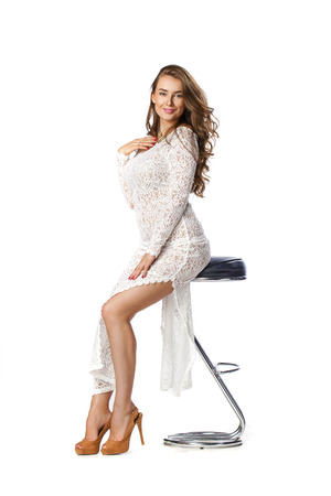 Fashion beautiful young woman with modern white dress posing in studio, isolated on white Stock Photo