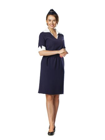 hostess: Front side, full body of a beautiful dark haired young business woman dressed in a dark blue suit with a blue scarf smiling, isolated on white background Stock Photo