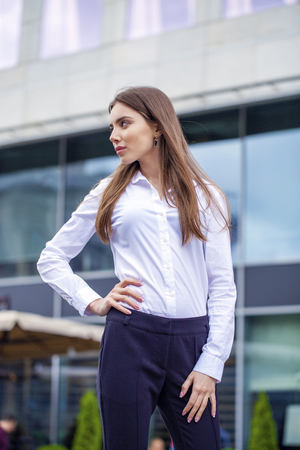 white shirt: Close up Portrait, young business woman in white shirt on summer street city Stock Photo