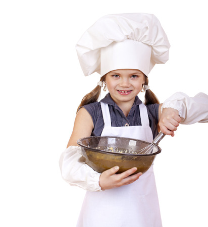 whips: Little girl cook whips whisk eggs in a large plate, isolated on white background