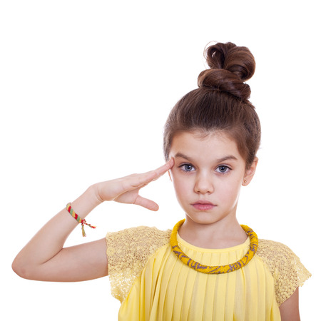 salutes: Teenager salutes, his hand on his head, studio on white background Stock Photo