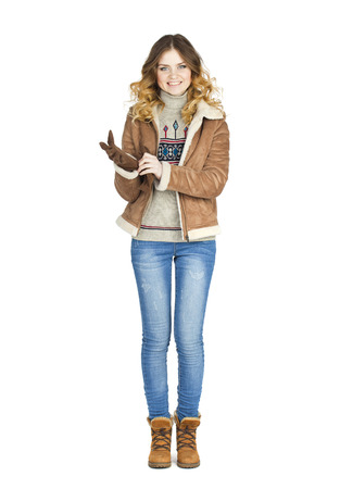 sheepskin: Young beautiful girl in a leather sheepskin coat and blue jeans isolated on white background Stock Photo