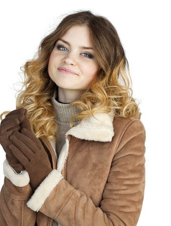 sheepskin: Young beautiful girl in a leather sheepskin coat, isolated on white background Stock Photo