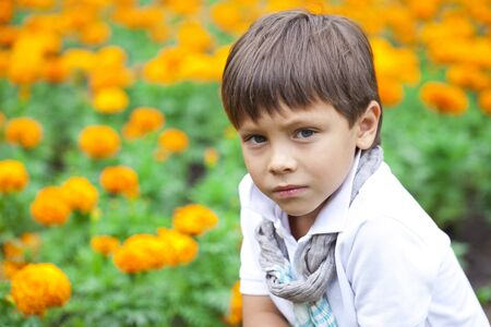 boy little: Portrait of adorable and fashionable little boy outdoor at the nice summer day Foto de archivo