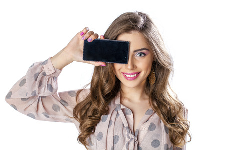 lady on phone: Sexy brunette showing smart phone isolated on white background Stock Photo