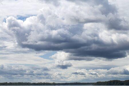 blue cloudy sky: Overcast clouds. Storm sky, rainy clouds over horizon