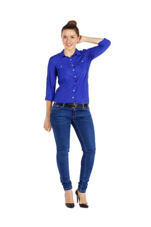 blue shirt: Full length portrait of a beautiful woman in blue jeans and shirt, isolated on white