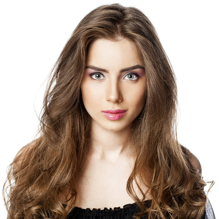 hairstyle: Beautiful Brunette Girl with hairstyle and make up isolated on white background