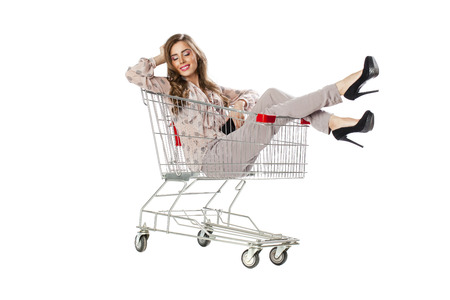 woman shopping cart: Happy young beautiful brunette woman sits in an empty shopping cart, isolated on white background Stock Photo