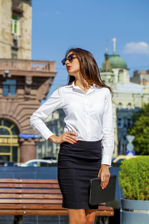 mirrored: Young beautiful business woman with blue mirrored sunglasses