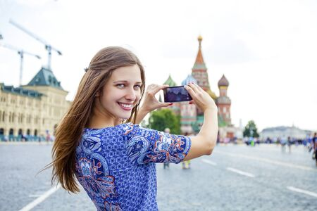 area sexy: Happy young brunette woman photographed attractions in Moscow