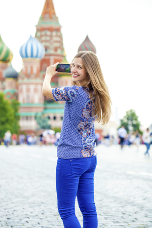 red square moscow: Selfie, Young beautiful girl photographed on a cell phone in red square, Moscow, Russia Stock Photo